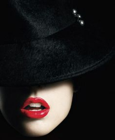 Another amazing example of sensuality....is it the red lips, the black hat or the light that lights up my imagination? News Flash! It's all of the above!