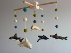 Welcome to visit FeltDreamShop.  I make each of my creations with love, dedication and attention to detail in a smoke & pet-free home.  Absolutely Adorable!  All pieces are handmade using the traditional dry needle felting technique from 100% wool.  There are 5 sea creatures and 14 felted balls in various sizes and colors.  - 1 Hammer Shark - 1 Shark - 1 Seal - 1 Dolphin - 1 Ray Fish   The frame size is +/- 33cm x 33cm (13) , felted figures are approx. 5,5 inches long.  The support (arm) is…