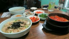 Dumpling Soup, Kimchijigae and Galbitang at a local good stand in Itaewon, Seoul, South Korea.