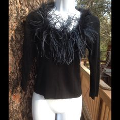 Charlotte Russe Top Darling long sleeve acrylic, nylon, and lycra top with feather trim! The feather collar is on with whip stitching, so it could be removed. The size is medium, but it does seem a bit small. In good pre-owned condition. Charlotte Russe Tops Tees - Long Sleeve