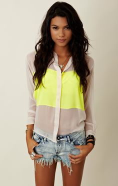 i must say i LOVE this shirt it combines the to trends of this summer neon and sheer!