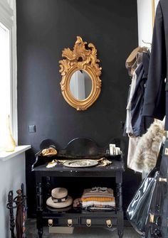 Love this #Black wall and #Gold #mirror