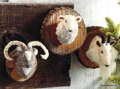 A trio of Alpine rams, made from wool felt and mounted on a log slice with keyhole hangers. The Bighorn Ram features festive gold thread detailing on his horns.