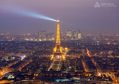 Eiffel Tower captured at dusk from the rooftop of Montparnasse Tower.