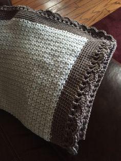 Tiramisu baby blanket pattern on Ravelry. 3 skeins Bernat Satin in Lapis and 2 skeins in Grey mist heather for the border!