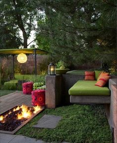 Inviting outdoor space. love the rectangle fire pit