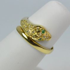 Stunning 18ct Gold Emerald & Diamond Ladies Snake / Serpent Ring by FineQualityJewellery on Etsy https://www.etsy.com/listing/266085146/stunning-18ct-gold-emerald-diamond