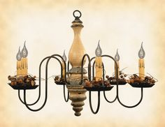 Wood & Metal Primitive Chandelier 6 ARM WOODEN CANDELABRA CEILING LIGHT This stunning primitive country chandelier will most certainly become the worthy centerpiece of whichever room you decide to gra
