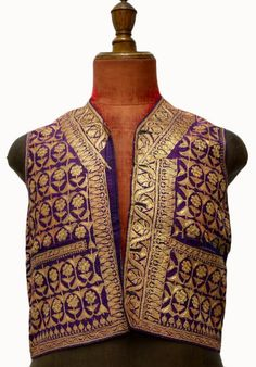 India, man's waistcoat, purple silk ground densely embroidered with gilt thread in floral and stylized patterns