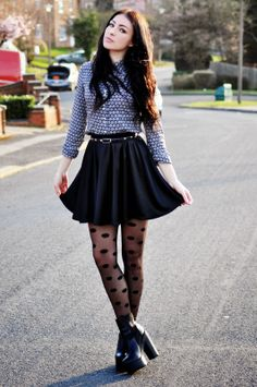 Cute outfit with the denim shirt with the black skirt, black heels, and black polka dot tights.