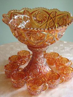 Imperial Glass Marigold Whirling Star Punch Bowl & 10 Cups   sold for $425