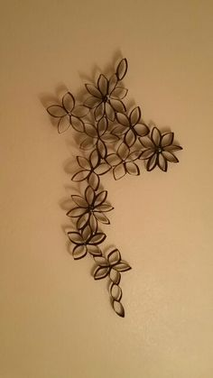 Finished product, flower decorative with marbles, papertowel&toilet paper rolls, super glue and black spray paint