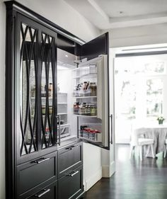 This Kitchen Really Stands Out With A Black Refrigerator Ed Mirrored Million Fridge Doors Fixed Above Paneled Freezer Drawers