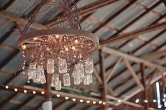 finally a use for the wagon wheel chandelier in my stinkin attic...and it's cute!