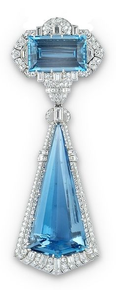 An Art Deco aquamarine and diamond brooch pendant, American, 1930s. Of strong geometric design, composed of a rectangular-shaped aquamarine surmount within a surround of single-, baguette-, torpedo-, and trapezoid-shaped diamonds, suspending a larger triangular-shaped aquamarine within a similar surround. #ArtDeco #brooch #pendant