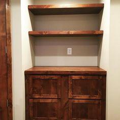 Custom Alder file cabinet and floating shelves#kitchencabinets #hardwood #customwoodwork #bathroomvanity #entertainmentcenter #lnk #classicwood via ClassicWoodLincoln.com