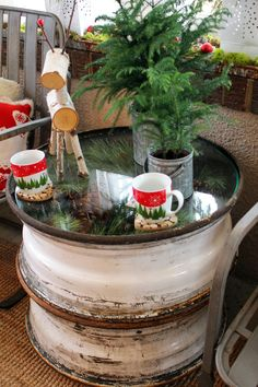 Old truck tire rims, stacked and topped with glass, make a perfect side table for the porch...year round!  Itsy Bits and Pieces: The Bachman's 2013 Holiday Ideas House...