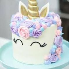 Homemade Unicorn Cake.very easy to make unicorn cake.delicious and yummy unicorn cake. simple unicorn cake recipe with a yummy layer of the cream cheese and vanilla, and topped with a waffle cone makes a unicorn simple or homemade unicorn cake. #cakes #Unicorn Cake #Homemade Unicorn Cake Unicorne Cake, Cupcake Cakes, Cupcakes, How To Make A Unicorn Cake, Easy Unicorn Cake, Unicorn Birthday Parties, Birthday Cake, Unicorn Party, Zucchini Cake