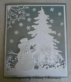 "Marianne Design tree.  The snowman is the new snowman from Marianne Design  .  The snow border along the bottom of the card is the Memory Box ""Frostyville Border"" and the corner die is the Memory Box ""Snowflake Corner"". I saved the snowflakes from the Martha Stewart ""Aspen Snowflake"" border punch for additional snow."