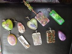 Swirl Resin Pendants Jewelry Tutorial - site has links to video tutorials