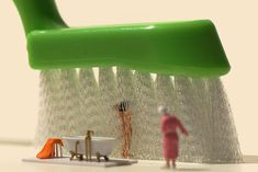 Miniature Calendar, figurines shot by Tanaka Tatsuya- Still life of little people taking a shower.