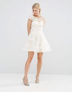 Image 4 ofChi Chi London Petite All Over 3D Floral Applique Mini Skater Dress