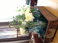 Flower center piece with mason jars and old wooden box