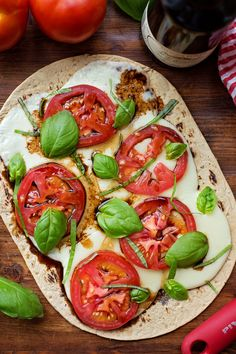 "Caprese Flatbread Pizza - mozzarella, tomato, basil and balsamic vinegar   Although its not ""traditional"" pizza, its pizza just the same!"