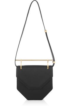 Handmade Black leather (Calf) Adjustable detachable shoulder strap, signature metal top handle Designer-stamped gold hardware Internal patch pocket Fully lined in black leather Concealed snap fastening at front