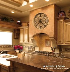 Love, Love, Love the decor above the stove and tuscany theme!