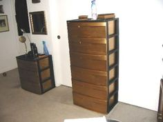 I bought two of these and stacked them then I painted the drawers with gold leaf. $18.97 ea