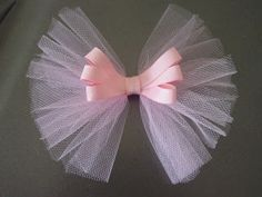 "This is my new tutu bow. Now tutorial: things you need tulle and 3/8"" grosgrain plus alligator clip first let us make the tulle bow 1.Cut th..."
