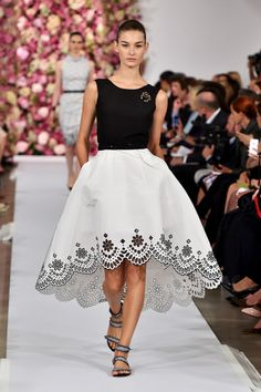 """""""There is no one on earth who makes a woman feel more beautiful than Oscar de la Renta,"""" thus said Karlie Kloss on her Instagram feed postshow. So far, the supermodel's selfie with the designer has more than 23,000 likes. But, really, who's going to argue with her after seeing his gorgeous Spring '15 lineup? The collection hit all of Oscar's signature marks: feminine, unfailingly polished, lush with color. Less…"""