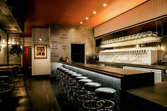 The 30 tap system is clad in a light Calcutta marble. Hogwash, a bar project in SF.