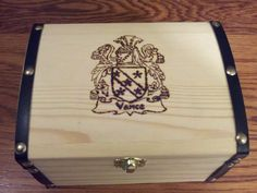I burned the Vance family crest into the top of this small chest for Justan's Christmas present. This was my first attempt at pyrography.