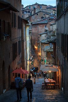 Street at sunset in Siena in Tuscany