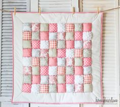 adorable pink, gray, and white puff quilt