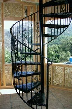 If you'd love the have all the advantages that a spiral staircase has to offer, but think the look might be a tad too modern, cast iron spiral stairs may be the perfect solution of blending a modern structure with a traditional material. Iron Staircase, Staircase Design, Iron Railings, Spiral Staircases, Circle Stairs, Attic Living Rooms, Stair Shelves, One Story Homes, Tuscan Design