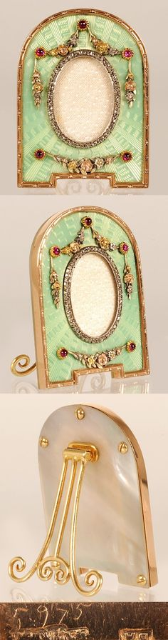 Faberge's frame. This frame was made by workmaster Johan Victor Aarne sometime between 1890-1908. The gold bordered arch is enameled in pale, translucent green over a radiating guilloché ground. Over the enamel sits decorative floral swags in four-colored gold, accented with cabochon rubies. The back of the frame is made of mother of pearl, and has a hinged, guilt scrolling strut. The hight of the frame is 1 5/8 inches (4.1 centimeters)