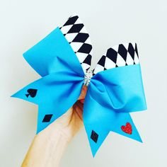 Alice In Wonderland Cheer Bow! Spandex with glitter detail! Ponytail holder attached! FREE SHIPPING! We offer discounts on large team orders!