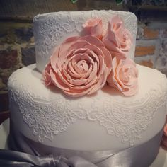 Three tier wedding cake with peonies, roses and lace