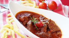 German Goulash or Gulasch is our family tradition for large gatherings. I prepare two large pots and serve it with Spätzle or wide noodles Pork Goulash, Louisiana Chicken Pasta, Beef Fillet, Clean Eating, Healthy Eating, Gym Food, Chicken Pasta Recipes, Healthy Soup Recipes, Pampered Chef
