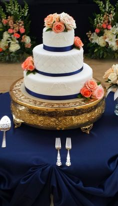 Navy and coral wedding cake. I usually like wedding cakes plain and white but this is super classy!