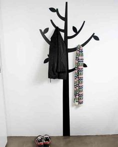 Love this!  What a fab way to hang coats!