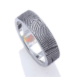 Or maybe this one.... Custom+Fingerprint+ring+6mm+Sterling+Silver+by+fabuluster+on+Etsy,+$295.00