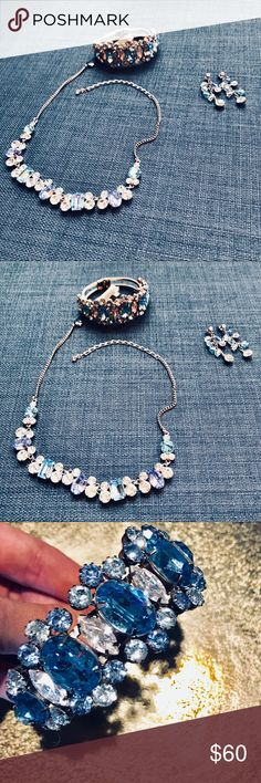 Genuine Austrian Crystal Set - Multi Blue NWT This genuine Australian crystal set comes with a bracelet, adjustable necklace, and set of earrings. Never worn. New with tags. Part of the Dillards crystal collection. Nickel free. Absolutely beautiful set! Dillards Jewelry Necklaces