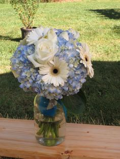 bride's Bouquets -ordered flowers from costco (roses, hydrangeas, and gerbera daisies) -floral tape (from walmart) -sharp sheers/scissors -starting in centre tape 3-5 five flowers at a time and add as you go until you get to the desired size