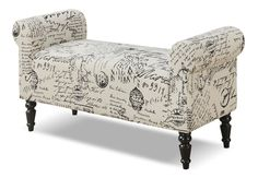 Post Marked. With its faded scroll and antique postal stamps, the fabric on the Tisdale bench is a veritable love letter to the past, ready to add a dash of charm and romance to your space. The roll arms create an elegant silhouette that's emphasized by stitched details, and darkly finished, turned legs are chic yet graceful. Customer assembly is required.   Available online only.