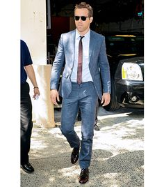 Ryan Reynolds in Etro suit; Burberry tie and shoes.I normally have a pet peeve about men not buttoning the jacket, but he really pulls it off because the jacket is fit extra slim in the waist and the pant hits at the right spot. My favorite thing here is the shiny oxblood Burberry shoe, which really dresses up the summer suit and brings it nicely into fall.""