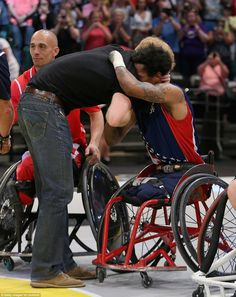 Harry shares an emotional embrace with a double amputee member of the US wheelchair basketball team at the gold medal match